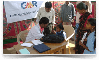 Image of doctor conducting a check-up on school children